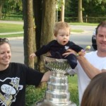 Young fan enjoying the cup with his parents